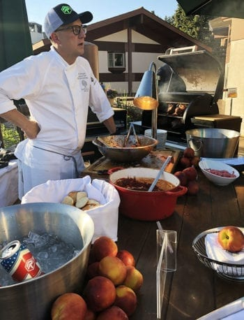 Chef Zane Holmquist chats with Hops on the Hill visitors. He's pairing his peach glazed pork sliders with RoHa Brewing Project's Three Deep American Ale.
