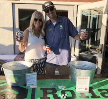 "Rob Phillips and his wife Melissa pour RoHa Brewing Project beer at Hops on the Hill. Rob is the ""Ro"" in RoHa."