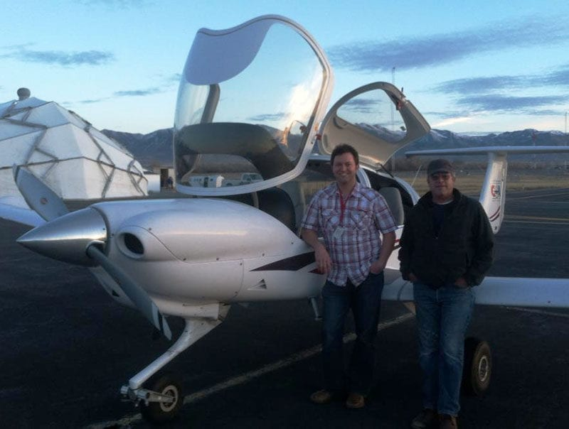 Ryan and his dad on the day of Ryan's first solo flight.