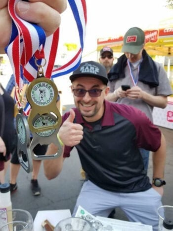 Chaz Smith picks up some hardware at the 5th Annual Lagerpalooza homebrew competition on May 5, 2019.